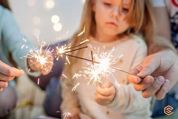 happy-family-light-sparklers-have-fun-fool-around-on-the-background-picture-id1280016696