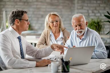 mature-couple-and-insurance-agent-using-computer-during-consultations-picture-id1183998991